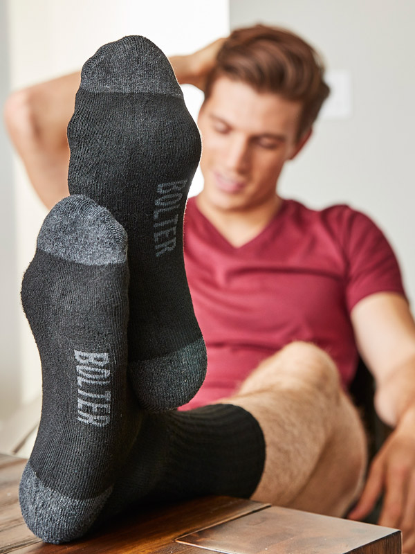 Black Crew Socks 18-Pack Fully Synthetic Guy Lounging at Home